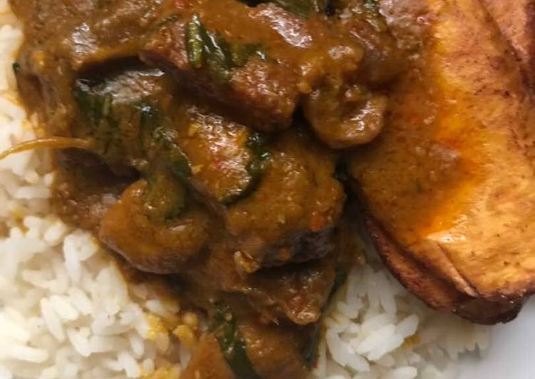 African Dish Banga Stew with White Rice and Plantain