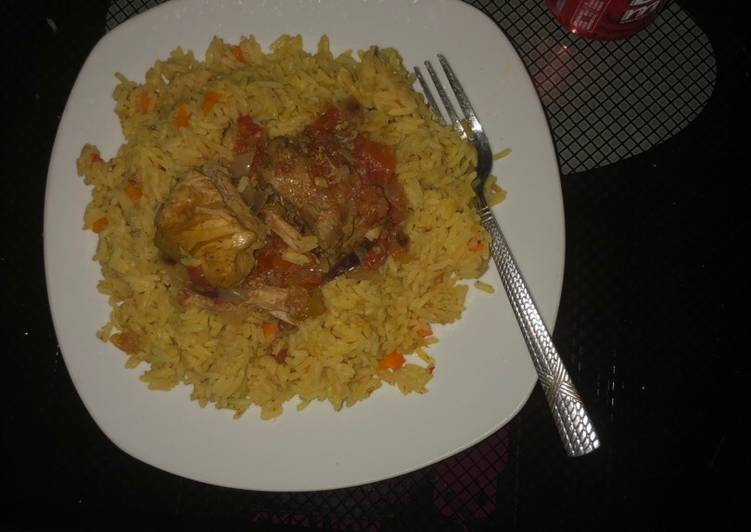 African Dish Carrot turmeric coconut rice with chicken sauce