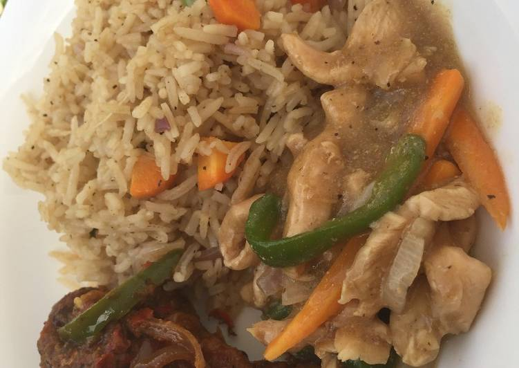 African Food Coconut fried rice with shredded chicken sauce