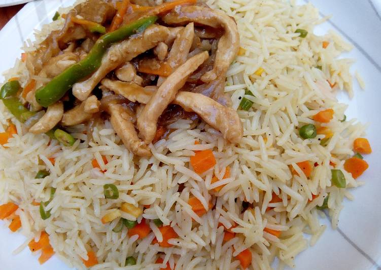 African Dish Coconut fried rice with shredded chicken sauce