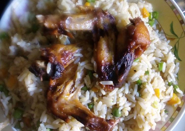 Traditional African Foods Coconut rice with chicken and veggies