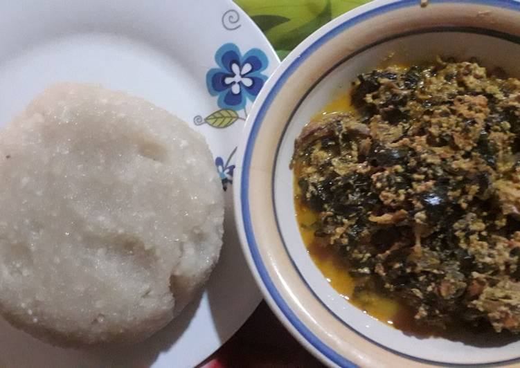 African Food Egusi soup with scent leaf and uzuza seed