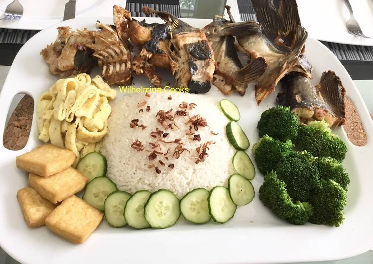 African Food Fried Blue Catfish with Coconut Rice (Nasi Uduk)