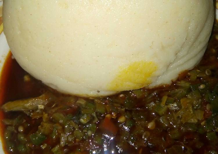 Semo and okro soup with dry fish