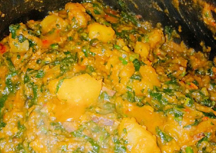 African Food Sweet potato porridge with ugba and ugu