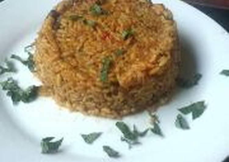 traditional jollof rice with locust beans recipe main photo